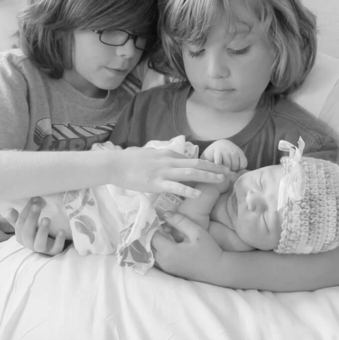 Newborn Picture with Siblings